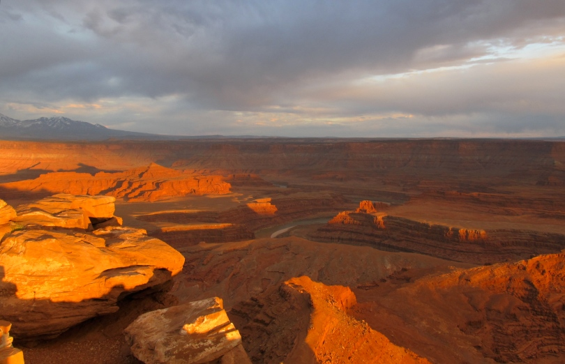 Sun's final rays illuminate the sandstone of Dead Horse Point State Park, UT.